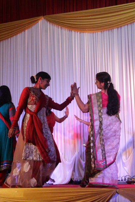 The bride and her mum performing a dance.