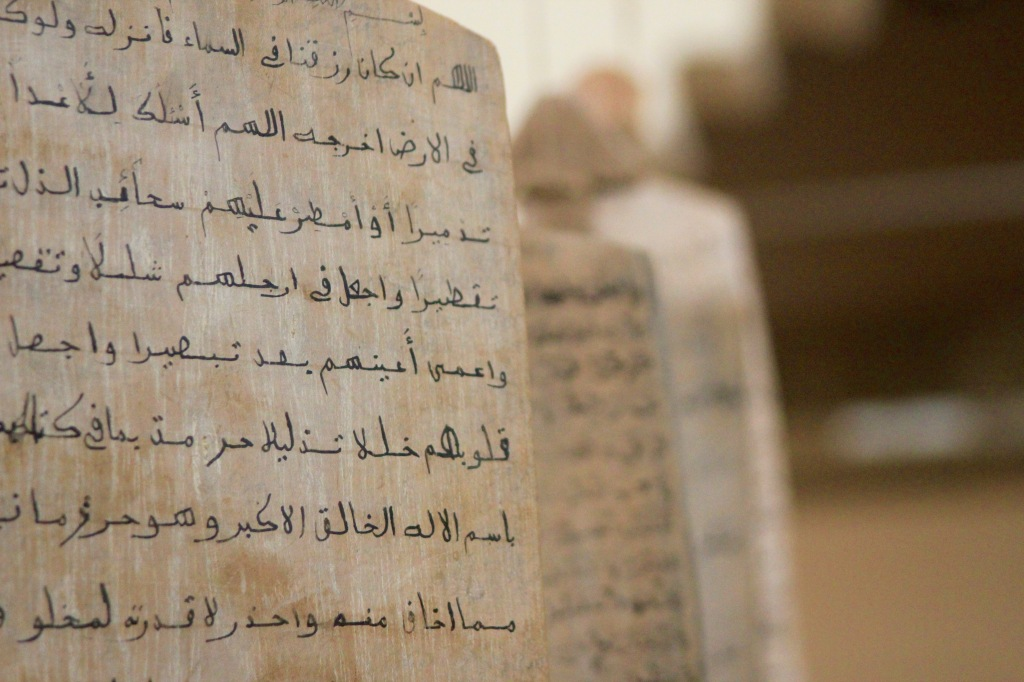 Verses from Quran written on wooden slabs by kids in Sudan.